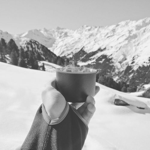 Cup of tea in the snow. Mountain One Person Rear View Outdoors Day Leisure Activity Refreshment Drink Cold Temperature Snow Human Body Part Close-up Tea Tea Time Hot Drink Backgroundblur Scenics Adventure No People EyeEmNewHere