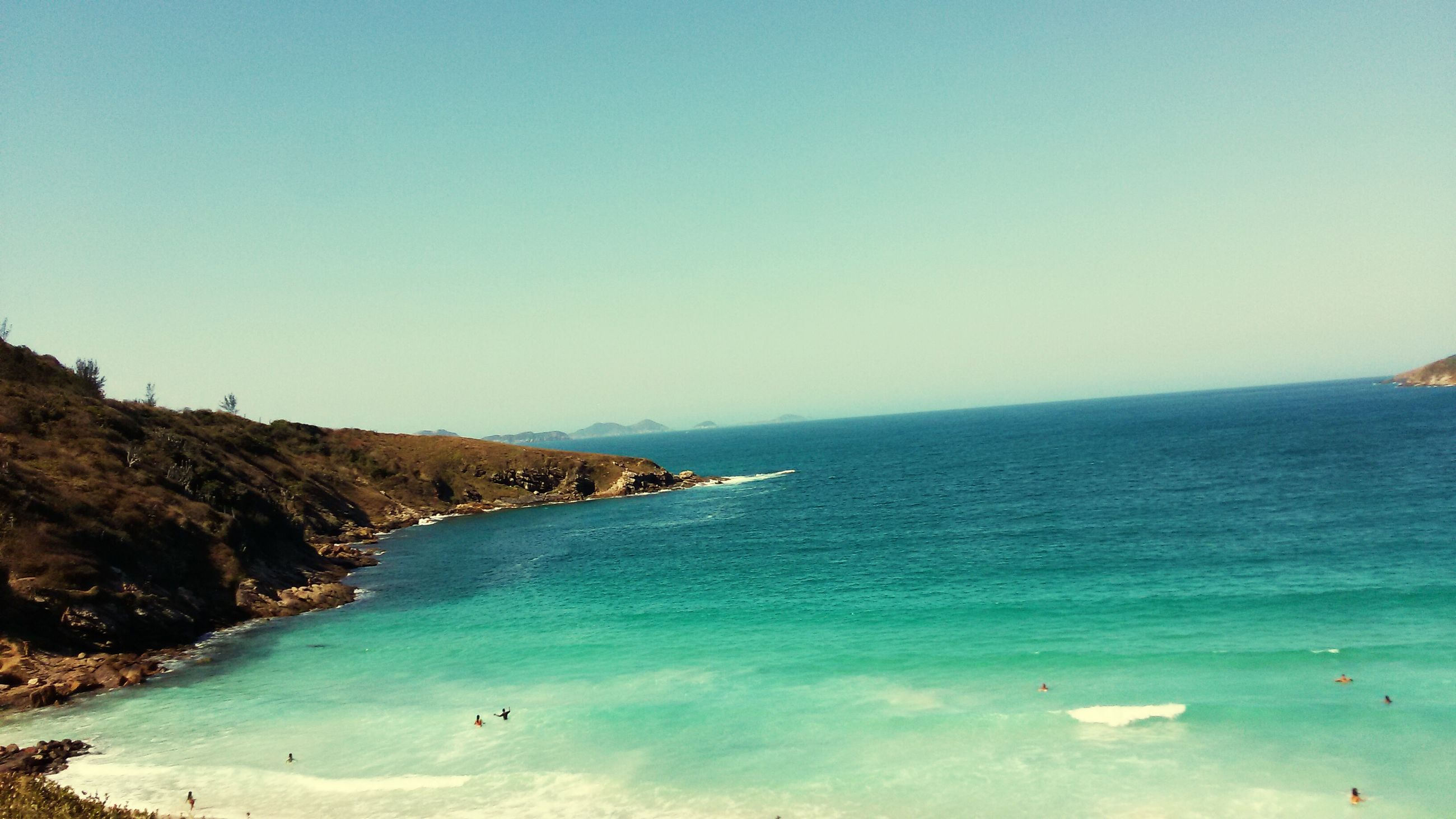 sea, horizon over water, clear sky, water, copy space, scenics, blue, tranquil scene, tranquility, beach, beauty in nature, nature, shore, idyllic, vacations, coastline, seascape, day, outdoors, incidental people