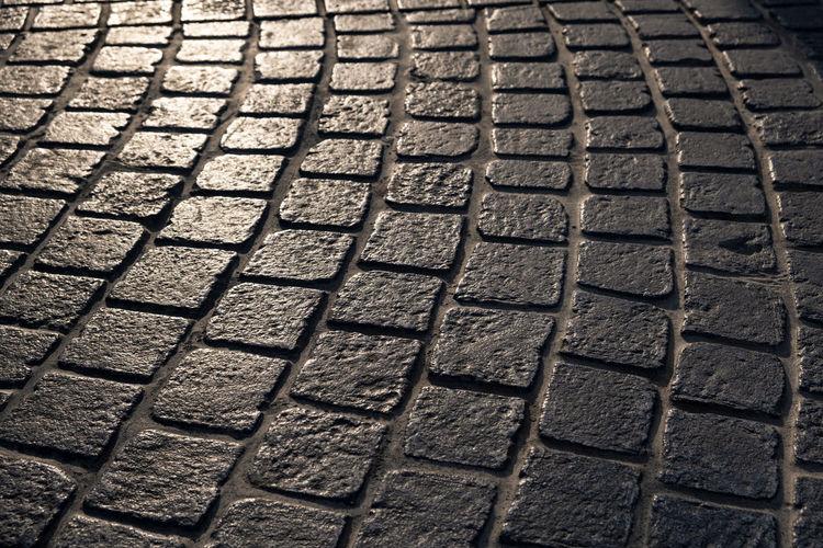 Full frame shot of tire tracks on street