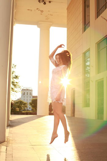Woman Levitating In Corridor