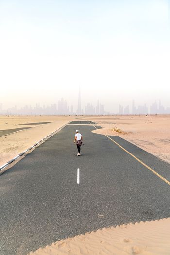 The world is yours Skate Photography: Same Tricks, New Perspectives Skyline Dubai Abandoned One Person Real People Sky Rear View Full Length Lifestyles The Great Outdoors - 2018 EyeEm Awards The Way Forward
