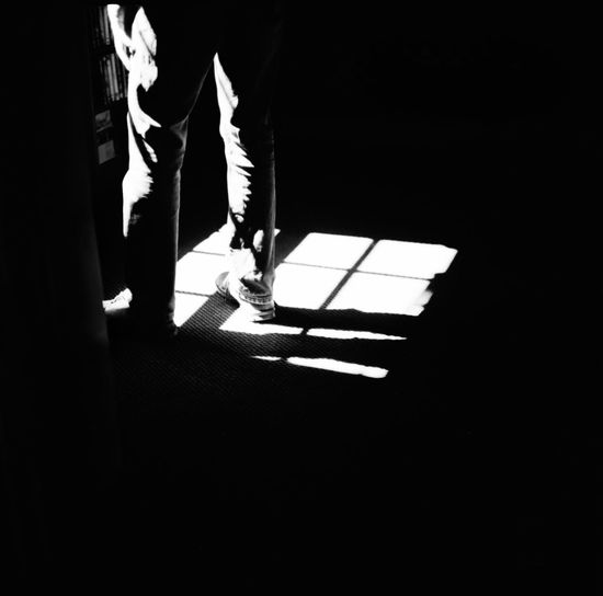 A man by the window Silhouette The Week on EyeEm Adult Adults Only Day Film Photography Human Leg Illuminated Indoors  Lifestyles Low Section Mamiyac220 Men People Real People Shadow Standing Streetphotography Two People Walking Window