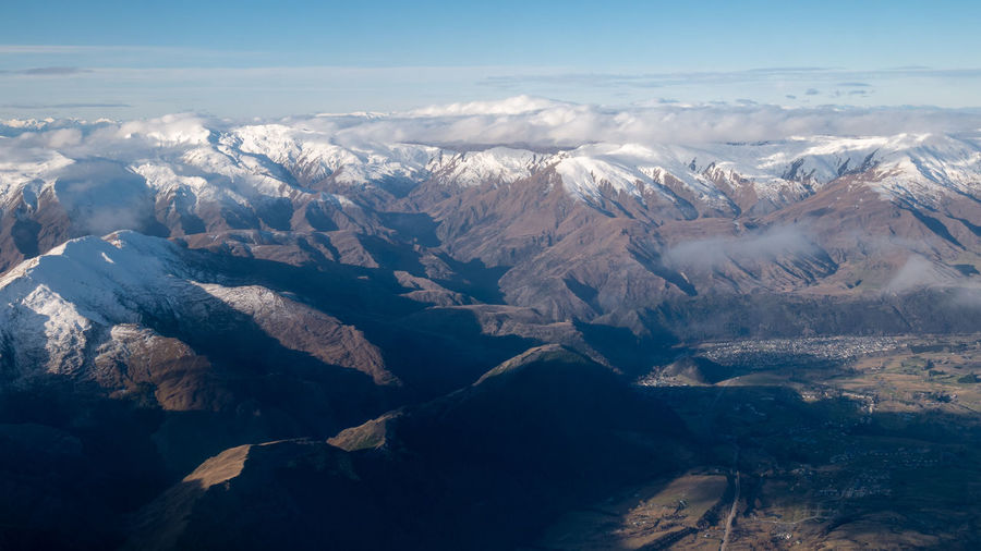 Mountains with snow caps, aerial shot of southern alpa made in queenstown, new zealand