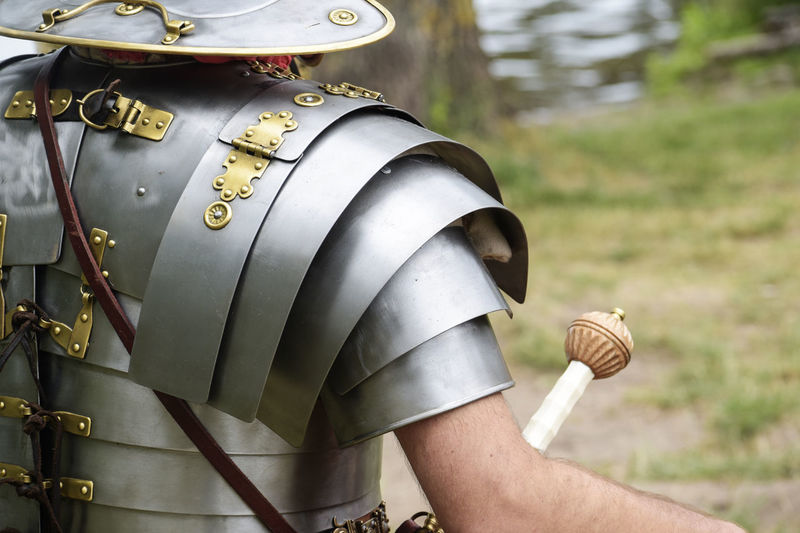 detail of an ancient roman soldier, legionnaire or centurion in metal armor at a historical festival, copy space Ancient Armor Man Soldier Armored Centurion Day Detail Festival Historical Human Body Part Legionnaire Metal Military One Person Outdoors People Roman Uniform Weapon