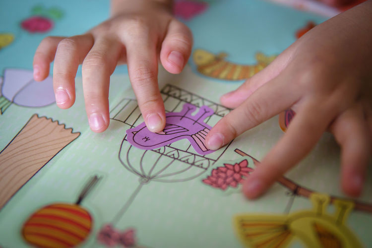 Close-Up Of Hands Making Craft