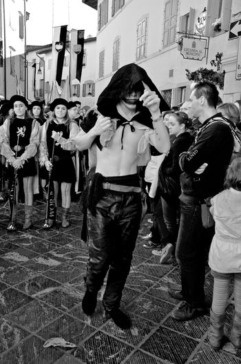 portrait of a man wearing medieval clothing during the parade Festa della Zucca Arts Culture And Entertainment Blackandwhite Photography Crowd Full Length Historical Parade Medieval Clothing Men Outdoors Parade People Portrait Real People Streetphotography Walking Welcome To Black