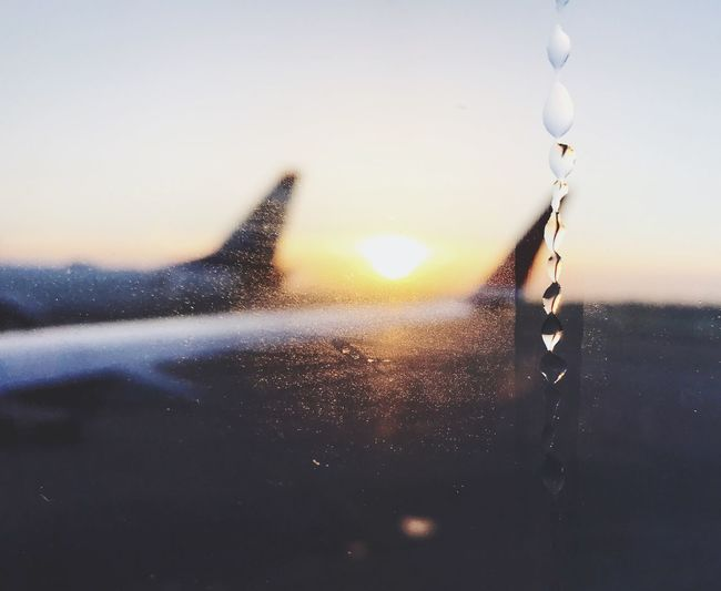Sky No People Nature Close-up Cold Temperature Water Sun Outdoors Beauty In Nature Day Droplet Droplets Airplane Window View From The Plane Window Sunrise Airplane Airplanes Airport Shotoniphone7 IPhoneography