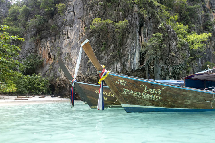Water Nautical Vessel Tree Plant Day Nature Beauty In Nature Transportation Mode Of Transportation Waterfront Mountain Longtail Boat Scenics - Nature Moored Outdoors Rock Land Rock - Object Non-urban Scene Rowboat Formation Thailand