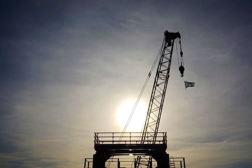 Crane Harbour Sky Cloud - Sky Silhouette Low Angle View Sunset Nature Architecture No People Built Structure Outdoors Sun Crane - Construction Machinery Construction Industry Sunlight Tall - High Industry Building Exterior Construction Site
