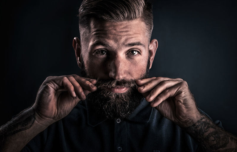 Adult Adults Only Beard Black Background Close-up Desaturated Front View Handsome Headshot Human Face Human Hand Looking At Camera Men Mid Adult Men One Man Only One Person Only Men People Portrait Studio Shot Uniqueness The Portraitist - 2018 EyeEm Awards The Modern Professional