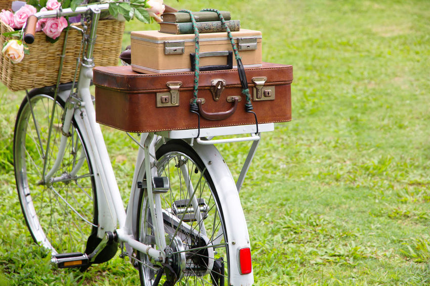 Vintage bicycle on the field with a basket of flowers and bag Cycle Cycle Of Life Old Fashion Style Retro Travel Travel Photography Traveling Vintage Style Vintage Bike Bag Bagage Bike Classic Bike Classic Cycle Cyclephotography Day Grass Nature No People Old Fashion Old Bike Outdoors Retro Style Vintage Vintage Cycle