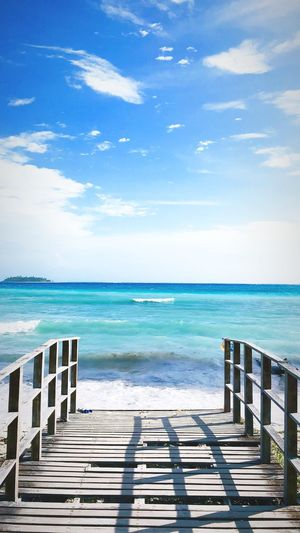 Water Sea Sky Horizon Over Water Horizon Cloud - Sky Beauty In Nature Outdoors Blue Tranquil Scene Sunlight Scenics - Nature Tranquility Land Beach Nature No People Wood - Material Day Idyllic