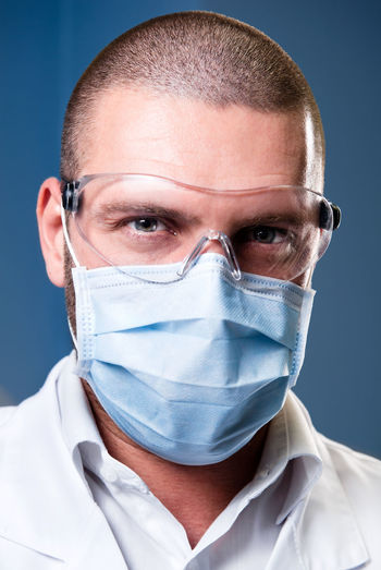Portrait of a serious confident doctor Dentist Dentistry Doctor  Hospital Medical Equipment Medicine Caucasian Clinic Close-up Confident  Dental Clinic Dental Health Doctor  Handsome Healthcare And Medicine Hygiene Medical One Person People Portrait Portrait Of A Man  Professional Occupation Protective Protective Workwear Surgical Mask