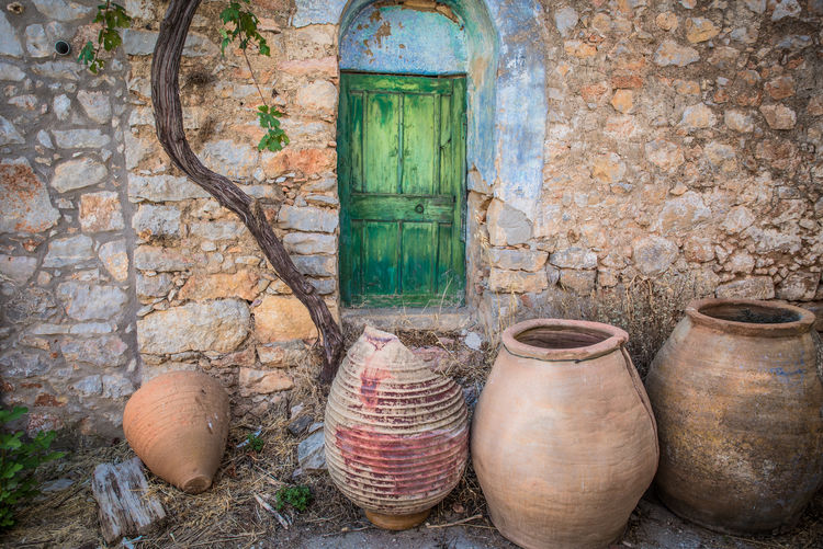 By Anna Wacker Abandoned House Dilapidation Architecture Art And Craft Brick Brick Wall Building Building Exterior Built Structure Ceramics Container Day Decay And Dereliction Decayed Beauty Door Entrance Greek Village No People Old Outdoors Pottery Stone Wall Wall Wall - Building Feature Wood - Material