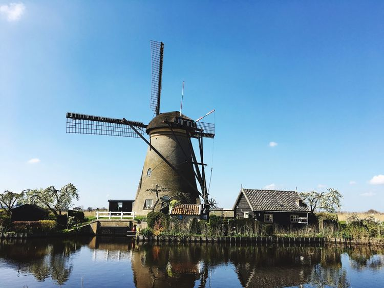 Environmental Conservation Windmill Built Structure Alternative Energy Fuel And Power Generation Wind Power Architecture Renewable Energy Traditional Windmill Wind Turbine Water Building Exterior Nature No People Sky Outdoors Beauty In Nature Day Industrial Windmill