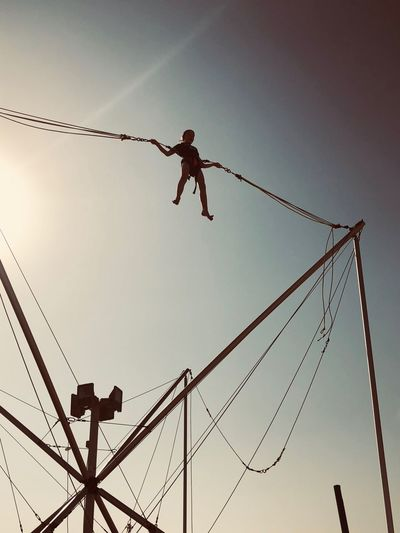 Bungee jumping on kite beach Dubai Jumera Beach Relaxing Holiday Kite Beach Bungee Low Angle View Rope Real People Silhouette RISK Danger Full Length Skill  Clear Sky Lifestyles One Person Outdoors