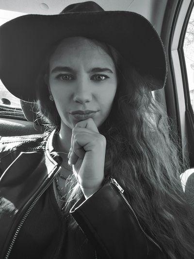 Portrait Of Woman Wearing Hat Traveling In Car