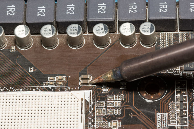 Close-Up Of Tool On Computer Chip