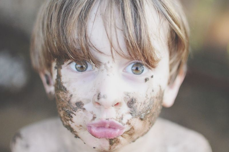Little boy with Hazel eyes covered in mud, making a Kissyface Kids At Play Childhoodunplugged Childhood Memories Muddy EyeEm Selects Looking At Camera Childhood Portrait Real People Boys Headshot Elementary Age One Person Focus On Foreground Innocence Front View Close-up Leisure Activity Cute Lifestyles Outdoors Shirtless One Boy Only Day