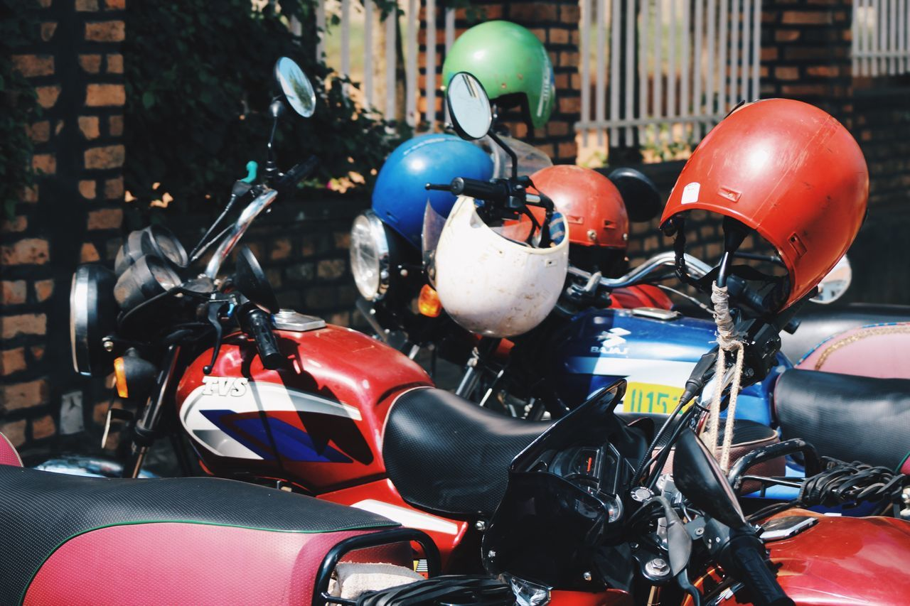 helmet, headwear, motorcycle, stationary, land vehicle, mode of transport, transportation, no people, day, outdoors, sports helmet, army helmet, close-up, scooter