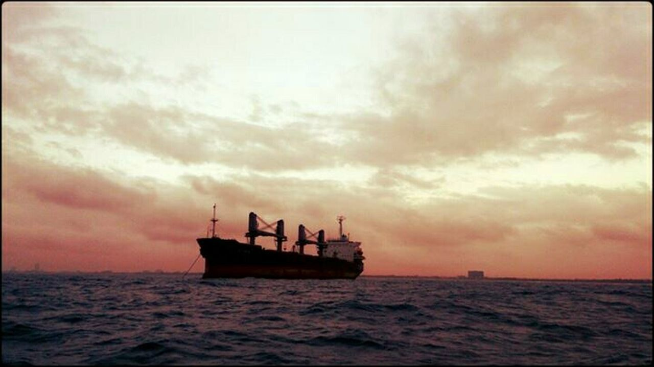 sea, silhouette, nautical vessel, sunset, cloud - sky, horizon over water, transportation, scenics, nature, outdoors, sky, water, sailing, adult, day, offshore platform, beauty in nature, adults only, people, sailing ship, only men, gondola - traditional boat, oil pump