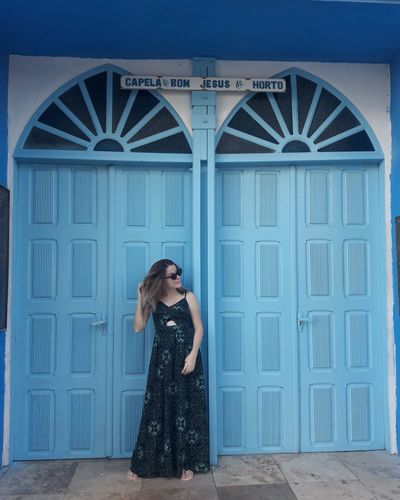 Full length of woman standing at entrance of chapel