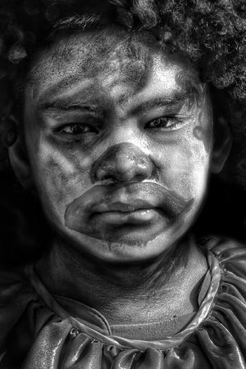 Close-up portrait of boy with face paint