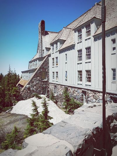 Timberline Lodge Ski Resort  Rock Wall Beauty In Nature Portland Oregon Buildings Architecture Buildings Eyem Best Shots Interesting Shots IPhoneography Hotel Relaxing Moments Vacations Eyemphotography Timberline Lodge Mt Hood Building Exterior Built Structure Architecture Sky Building Nature The Architect - 2018 EyeEm Awards Day No People Clear Sky Sunlight Shadow Sunny Tree Outdoors