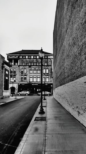 Black And White Photography OpenEdit Window Reflections Old Buildings Oldtown Architecture_bw Black And White Street Photography Check This Out City Lights After The Rain From Where I Stand Up Close Street Photograpy Up Close With Street Photography Blackandwhitephotography Black And White Collection  Streetphotography Sidewalk Street Lamp