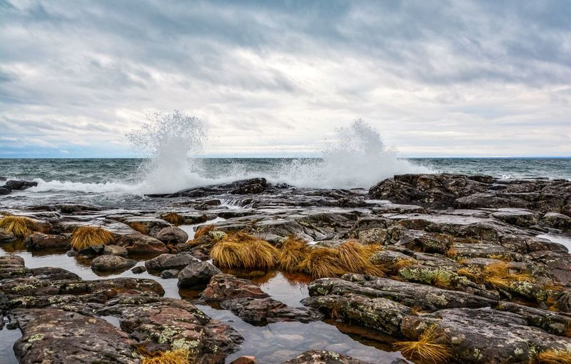 Sea waves splashing on rocks at beach