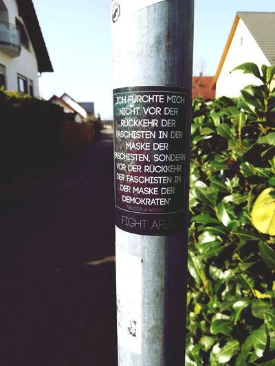 Fight AFD Streetlight Sticker Guerilla Statement Against Hate Crime Laterne Aufkleber Anti Afd Fight Nazis Blue Skies Guerilla Art Fight Afd Communication Text Close-up Sky Building Exterior Built Structure Architecture Street Art Signboard