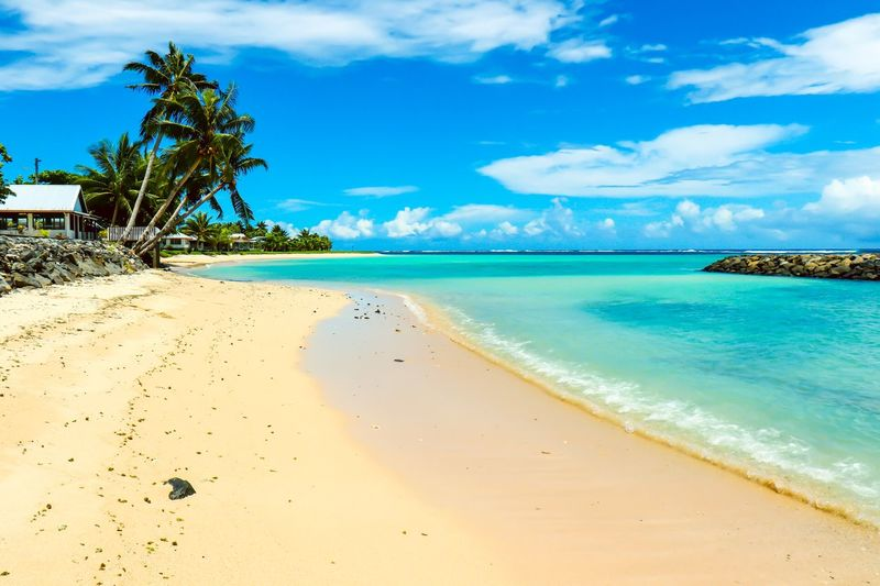 Stunning colors of Savai'i Serene Turquoise Lagoon Savai'i Beach Sky Sand Sea Beauty In Nature Scenics An Eye For Travel Water Palm Tree Tranquility No People Blue