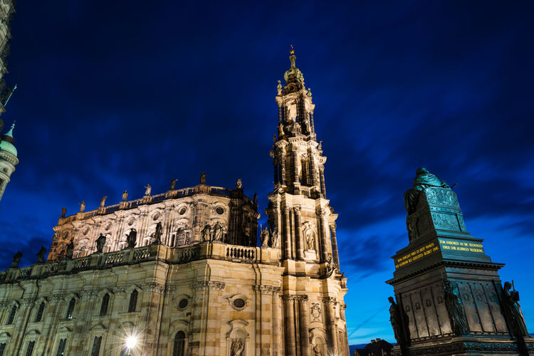 Low angle view of illuminated cathedral against blue sky