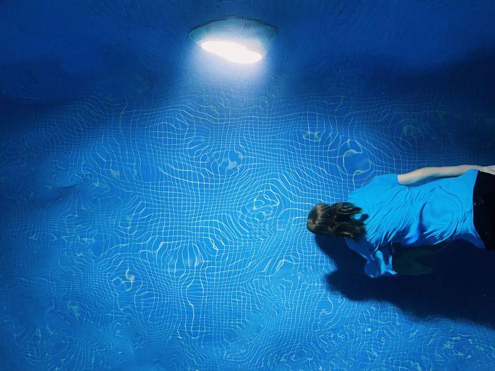 Girl swimming in pool