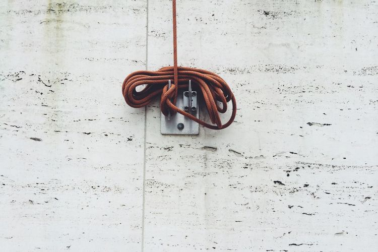 Low angle view of rope on wall