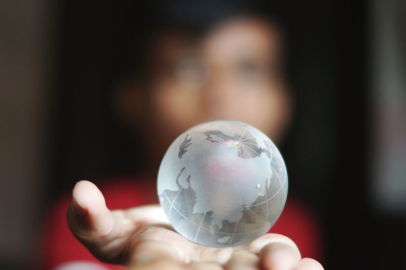 Woman holding crystal globe