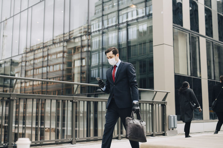 Young man walking in office building