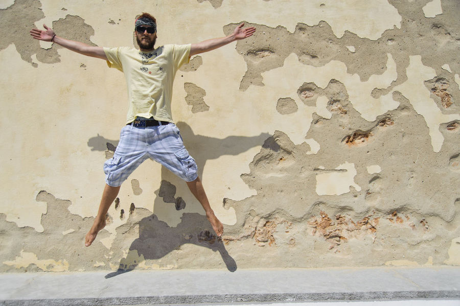 Adult Adults Only Arms Outstretched Day Full Length Human Body Part Jumping Man One Person Outdoors People Star Star Jump Travel Weathered Wall Young Adult Young And Free Young Man The City Light