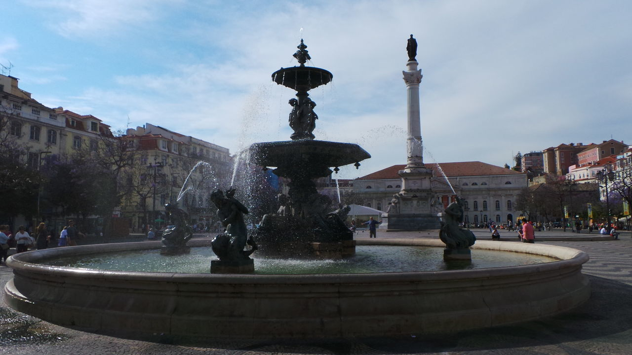 Fountain At Town Square Against Sky