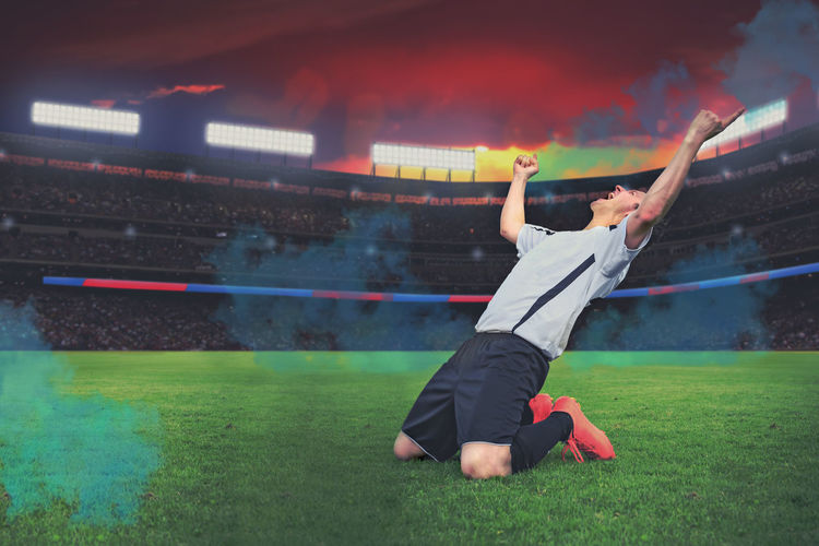 Soccer player celebrating on soccer field