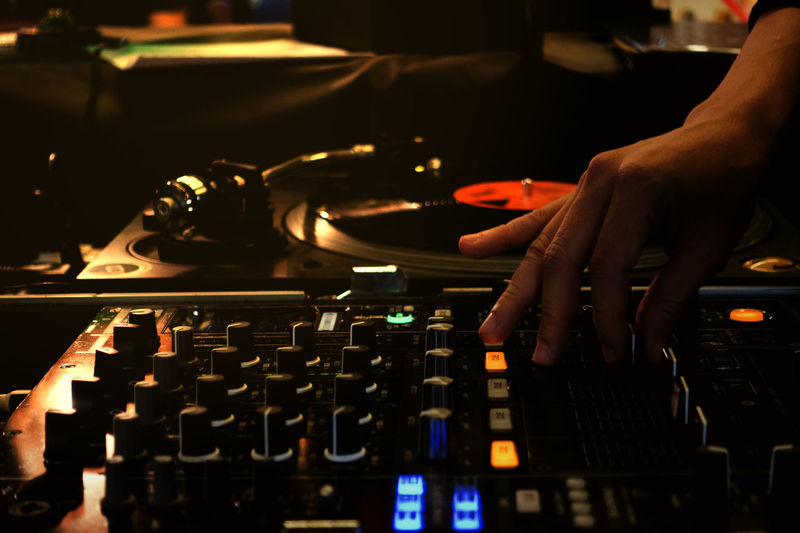 Colorful with hand adjust mixer drop beat by turntable DJ party at nightclub with low key and soft focus Adjust Close-up Club Dj Control Panel Culture Dj Expertise Hand Indoors  Instrument Men Mixer Mixing Music Nightclub Nightlife Occupation One Person Record Recording Studio Skill  Sound Mixer Technology Turntable Working First Eyeem Photo