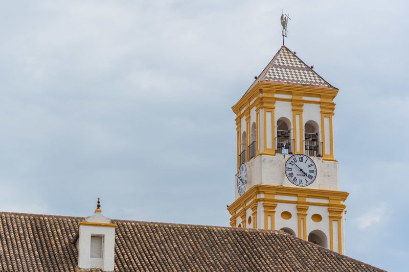 Low angle view of a church tower against sky in spain