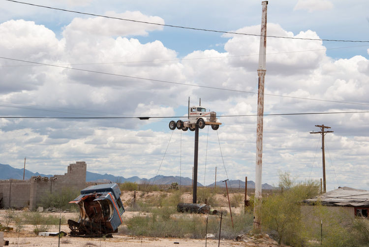 Cloud - Sky Transportation Sky Mode Of Transportation Day Nature Land Vehicle Technology Outdoors Machinery No People Mountain Motor Vehicle Cable Environment Plant Air Vehicle Industry Power Line  Construction Machinery Kingman Arizona Truck