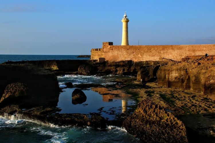 View Of Lighthouse At Seaside