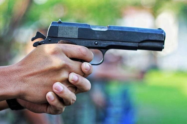 Cropped Hand Holding Gun