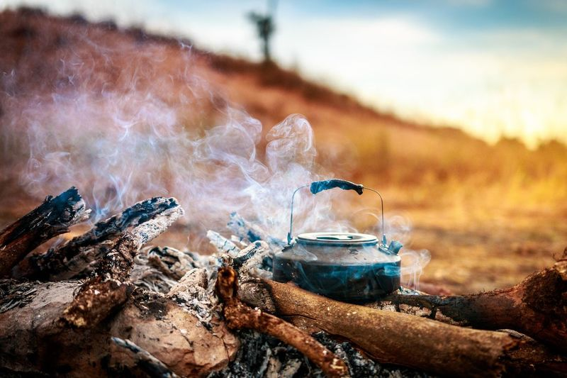 Bonfire Burning Campfire Camping Close-up Day Fire Fire - Natural Phenomenon Flame Focus On Foreground Heat - Temperature Land Log Nature No People Outdoors Smoke - Physical Structure Thailandtravel Tree Wood Wood - Material