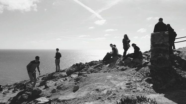 The People on the Cliff Enjoying The View People And Nature People_bw People Watching Cliffside Water Outdoor Photography Monochrome Outdoors Black And White Leisure Activity Enjoying Life Leisure Time Black & White Shadow Silhuettes People Silhouettes Black And White Photography Tourist Destination EyeEm Gallery EyeEm Nature Lover EyeEm Best Shots - Nature EyeEm Best Shots