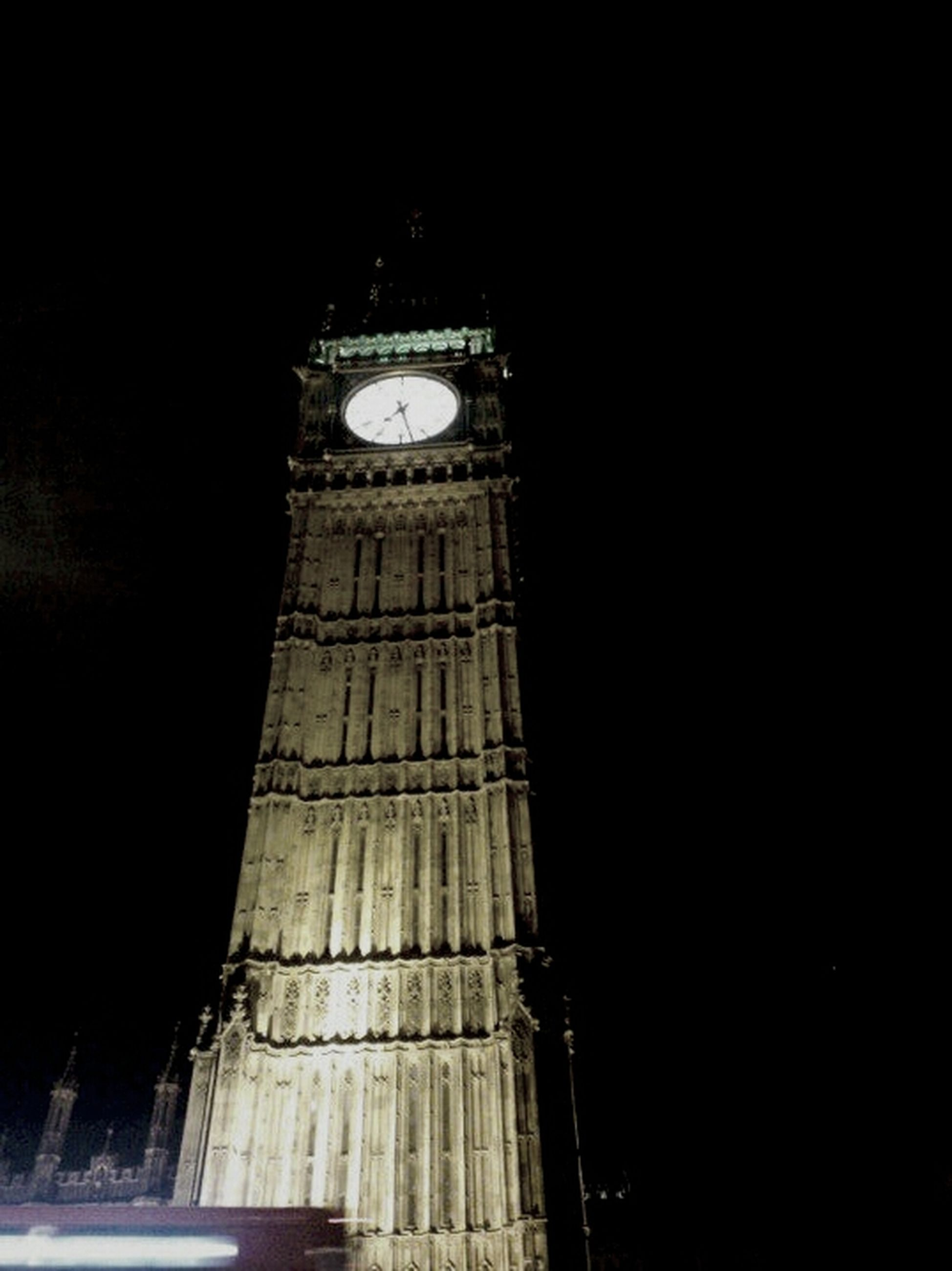 architecture, night, built structure, low angle view, building exterior, tower, international landmark, history, famous place, travel destinations, illuminated, tall - high, tourism, travel, capital cities, clear sky, sky, clock tower, architectural feature, no people