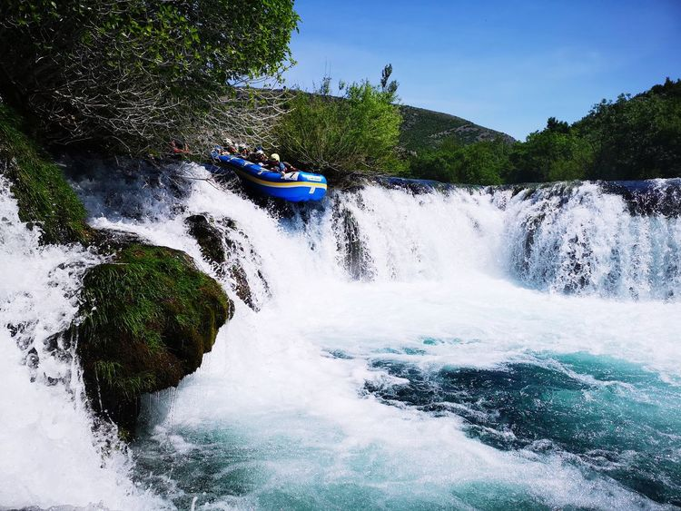 Rafting Raft Rafting!! Rafting Boat EyeEm Selects Summer Exploratorium Tree Water Motion Spraying Sky Waterfall Flowing Water Falling Water Natural Landmark Power In Nature Force