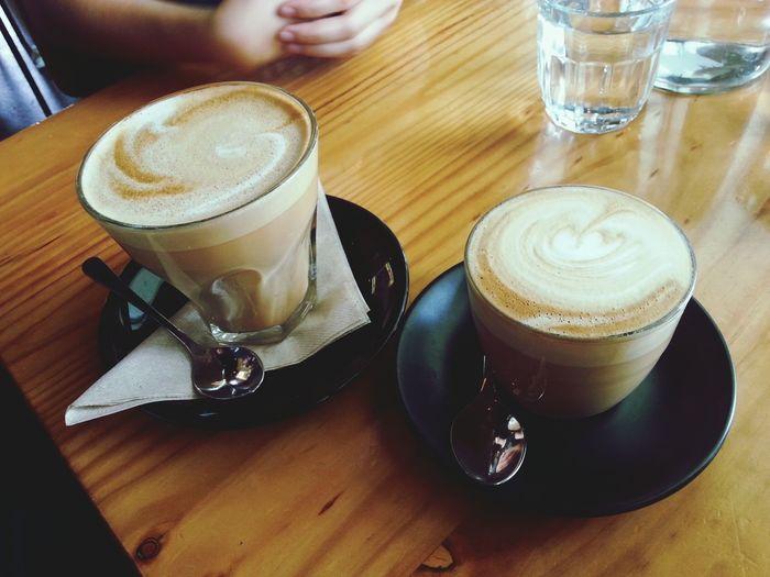 Big latte, little latte, cardboard box. Bae  Coffee Time latte